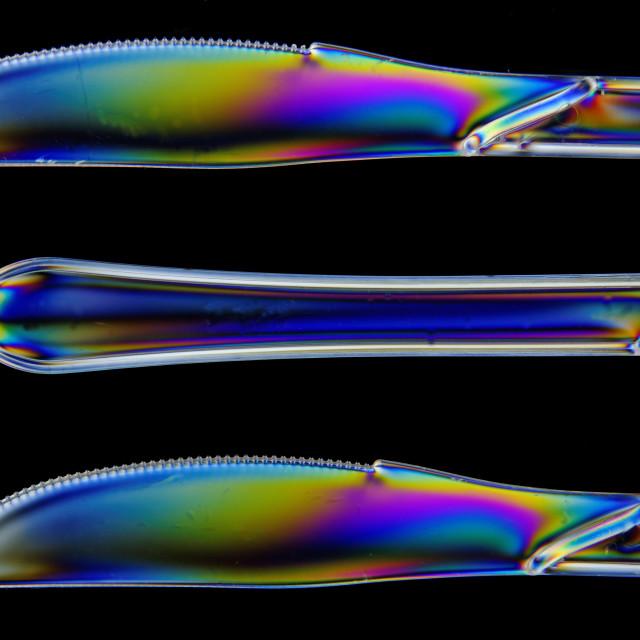 """Polarised Plastic Knives"" stock image"