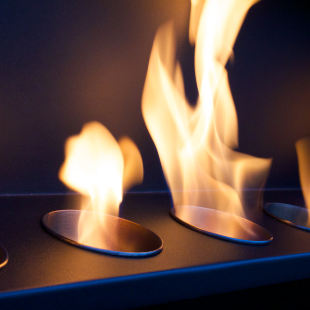 """Flames Licking Around a Bio-ethanol Fire."" stock image"