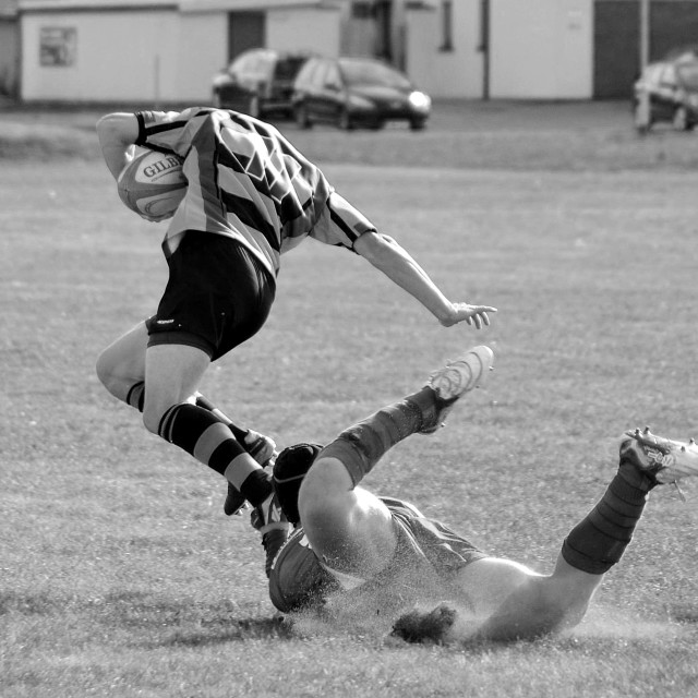 """Rugby tackle, catch me if you can"" stock image"