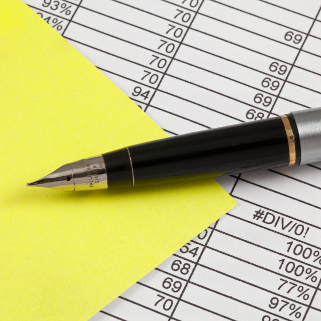 """Fountain Pen,Post-It and Spreadsheet"" stock image"
