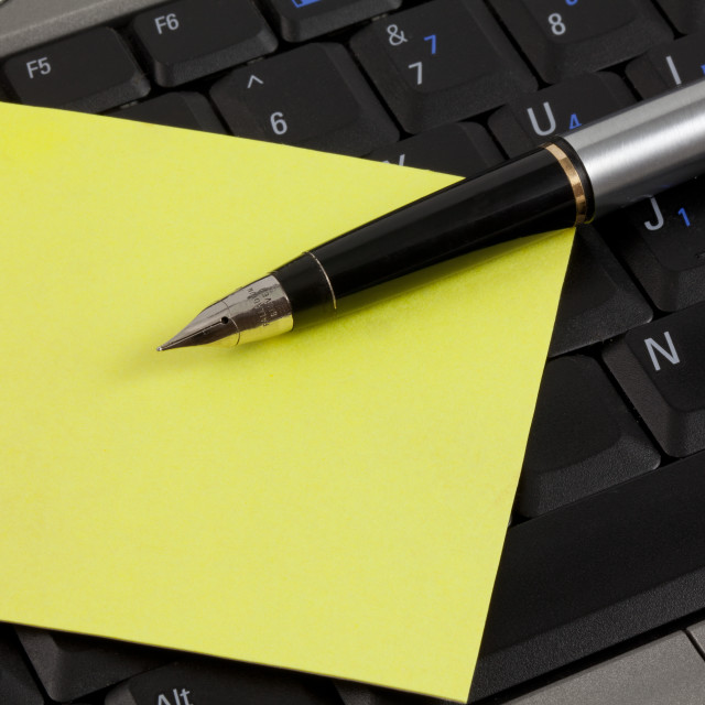 """Pen and Post it on a Laptop"" stock image"
