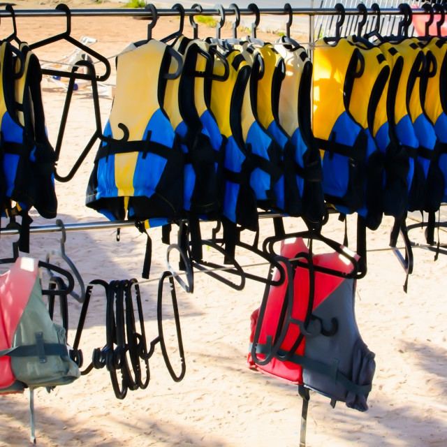 """""""Life jackets on a rack"""" stock image"""