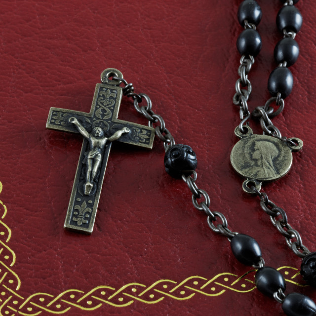 """Rosary on a Bible"" stock image"