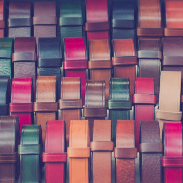 """Colourful belts at the market"" stock image"