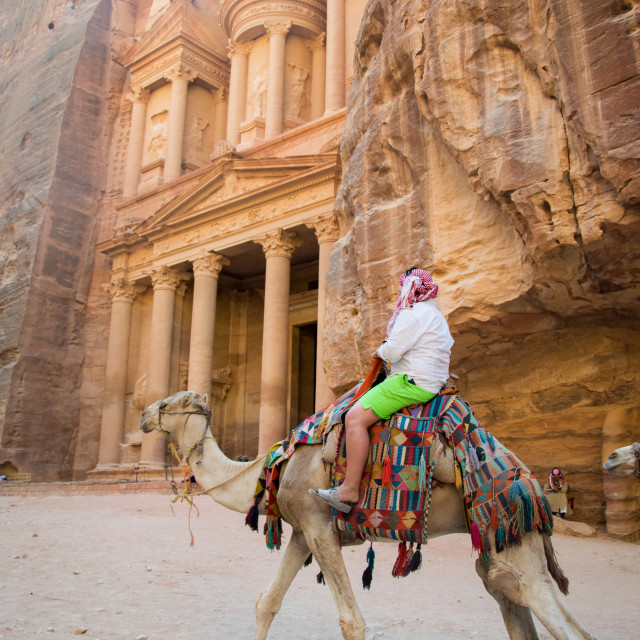 """Riding a camel at Petra"" stock image"