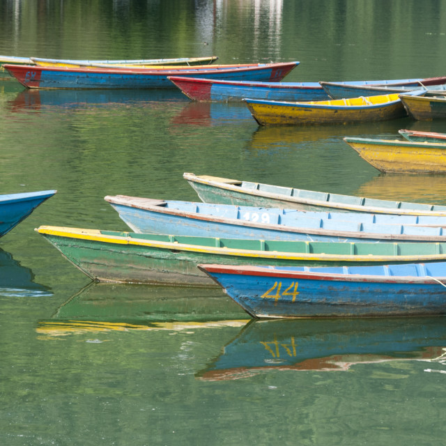 """Colourful boats drifting on a lake"" stock image"
