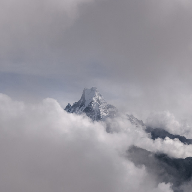 """Macchapuchare thorough clouds, Annapurna, Nepal"" stock image"