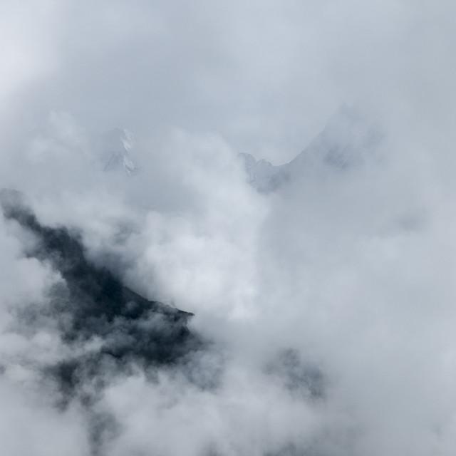 """Macchapuchare thorough clouds, Annapurna, Nepal"" stock image"