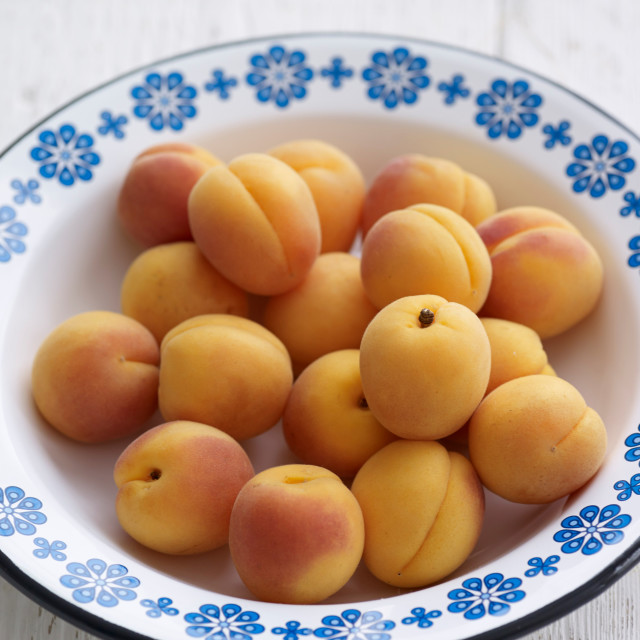 """""""Apricots in a bowl"""" stock image"""
