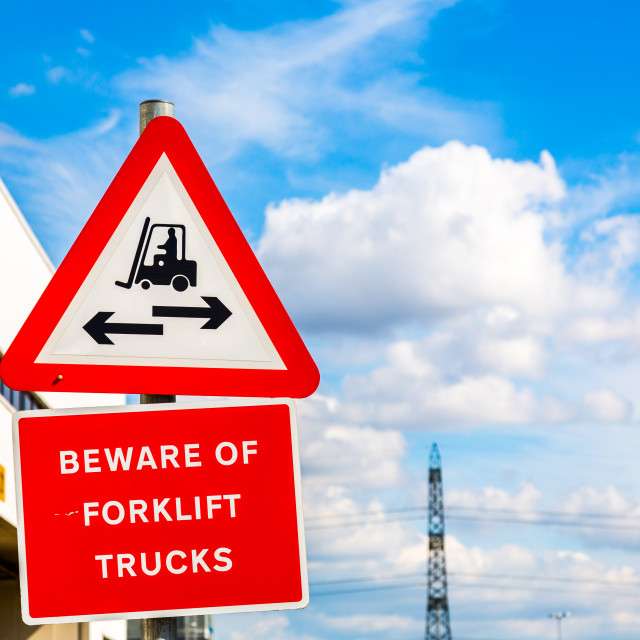 """Beware of forklift sign on blue sky"" stock image"