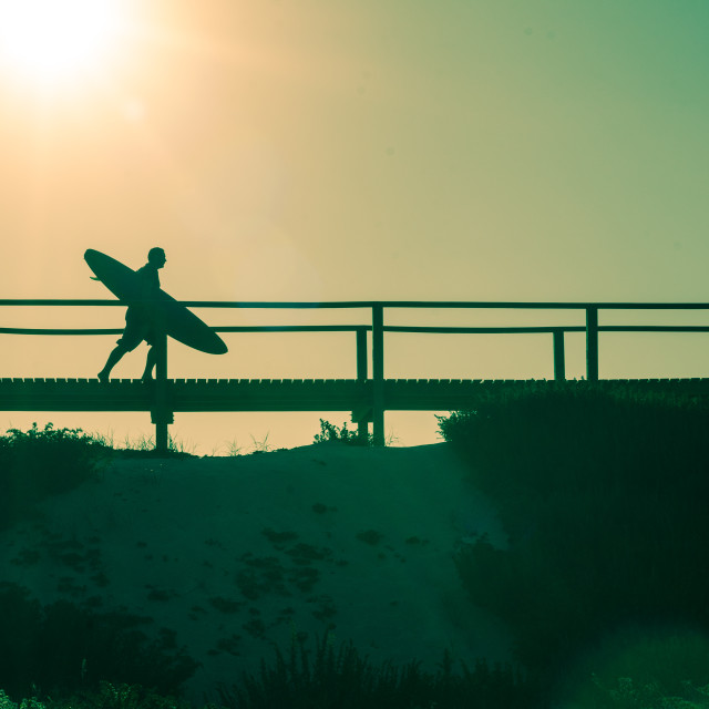 """""""Surfer running to the beach"""" stock image"""