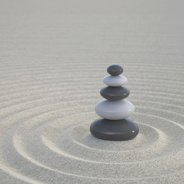"""Dark and white zen stones on a wide sands"" stock image"