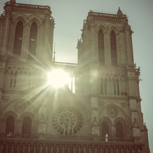 """Sunlight shining through towers of Notre Dame"" stock image"