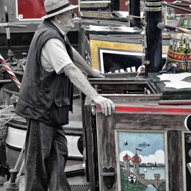 """Man on a barge"" stock image"