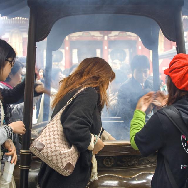 """""""Inhaling incense smoke in Tokyo"""" stock image"""