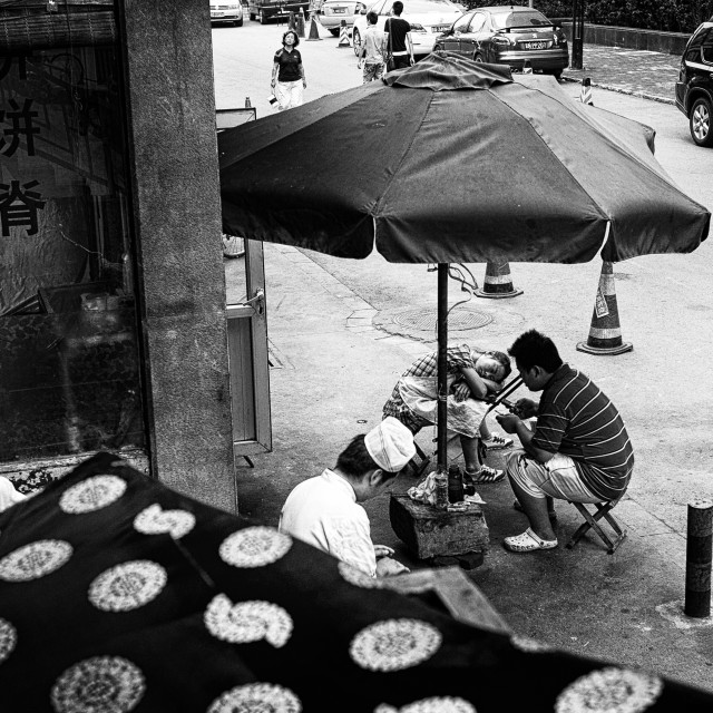 """Street scene with cooks"" stock image"