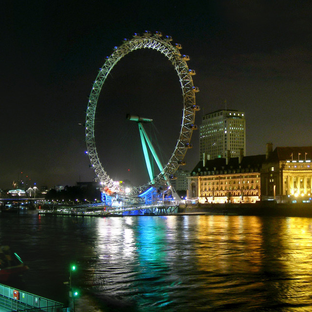 """""""London Skyline by Night - The London Eye and the Thames River"""" stock image"""