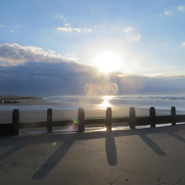 """Sunrise over breakwaters"" stock image"