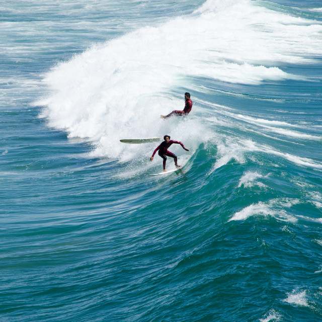 """Surfers in the sea"" stock image"