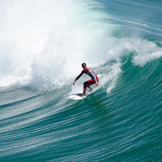 """Surfer in red"" stock image"