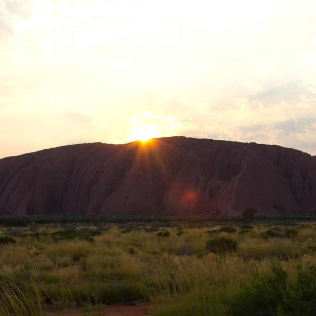 """Sunrise over Uluru"" stock image"