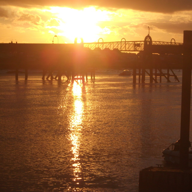 """""""Sunsetting over the old Shoreham footbridge"""" stock image"""