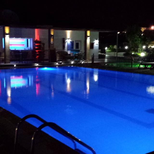 """Amfitriti Hotel swimming pool at night"" stock image"