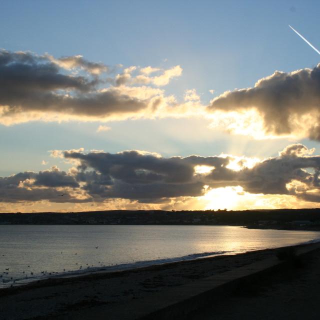 """Sunset over St Michael's Bay,UK"" stock image"