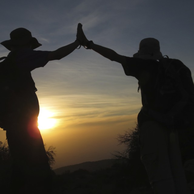 """Sunset high five"" stock image"