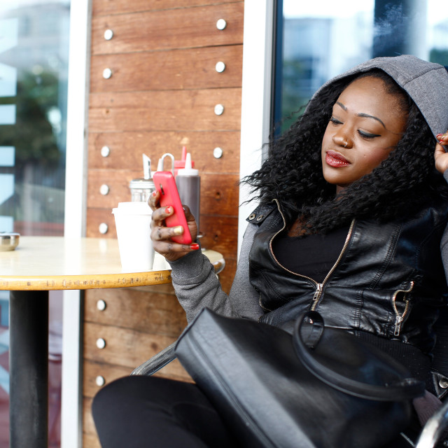 """Black Woman in Black Casual Outfit at Coffee Shop"" stock image"