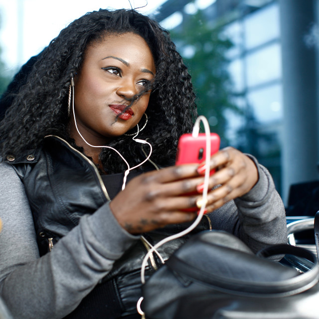 """""""Trendy young woman relaxing listening to music"""" stock image"""