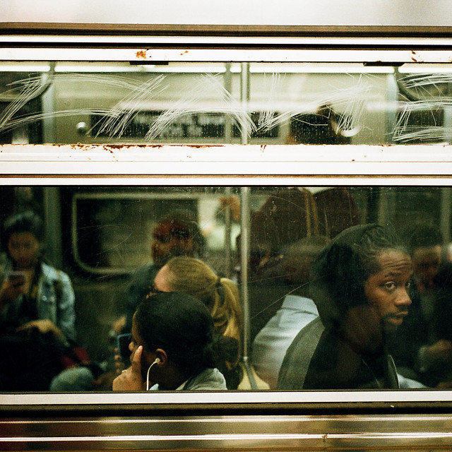 """On a train in NYC"" stock image"