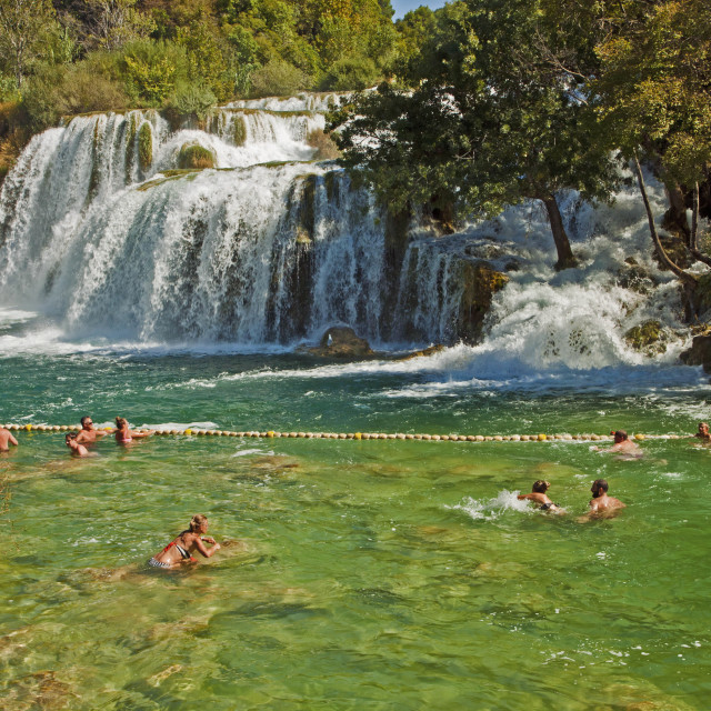 """Tourists swim at Krka waterfalls, Croatia"" stock image"