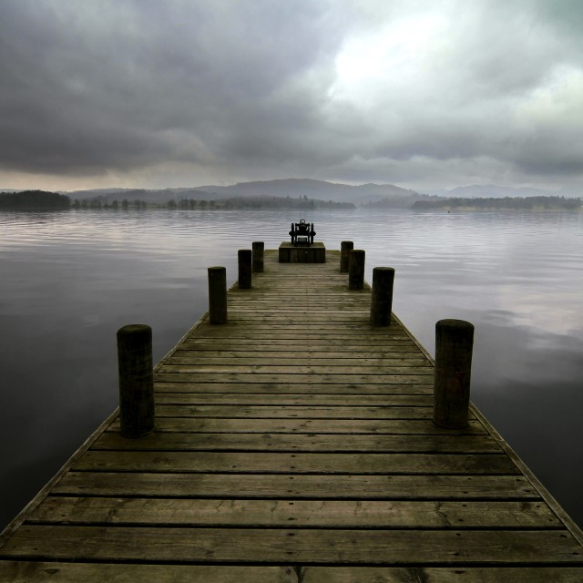 """Wooden Jetty on Calm & Mysterious Lake Windermere"" stock image"