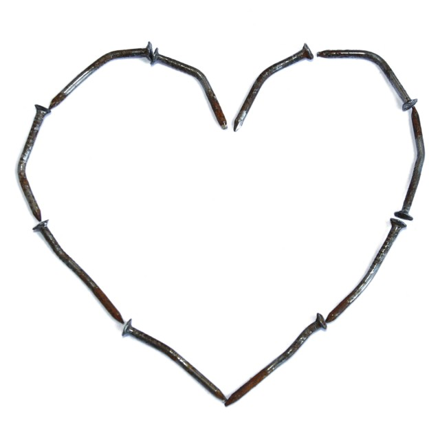 """""""Rusty nails in heart shape"""" stock image"""