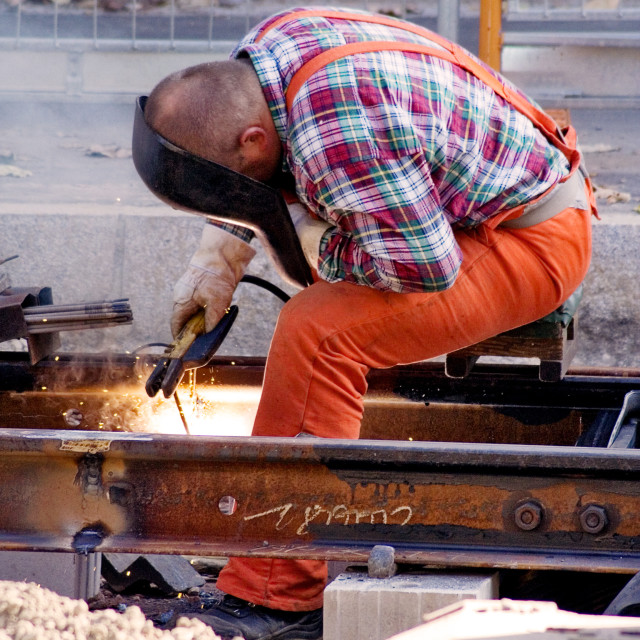 """""""Construction Worker Fixing Rails"""" stock image"""