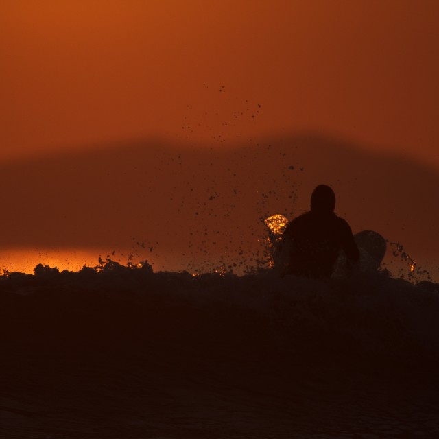 """Sunset Paddle Out"" stock image"