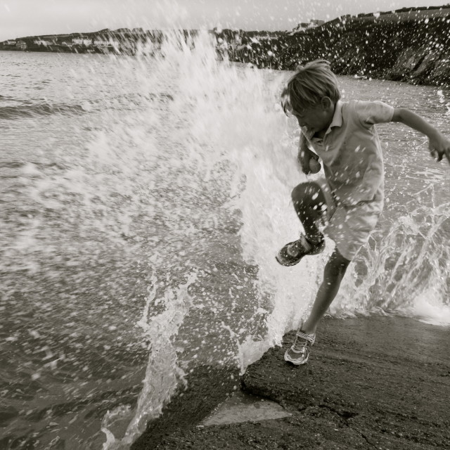 """""""Caught by the Wave"""" stock image"""
