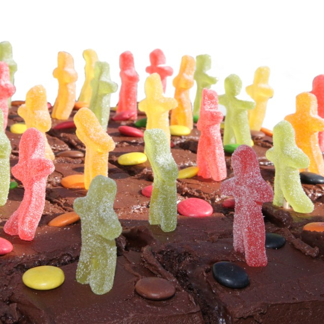 """""""Chocolate cake with jelly men isolated on white"""" stock image"""