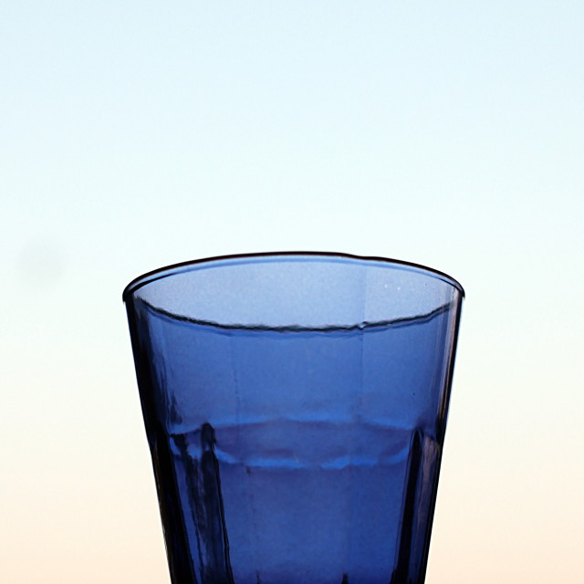 """""""Blue glass against evening sky"""" stock image"""
