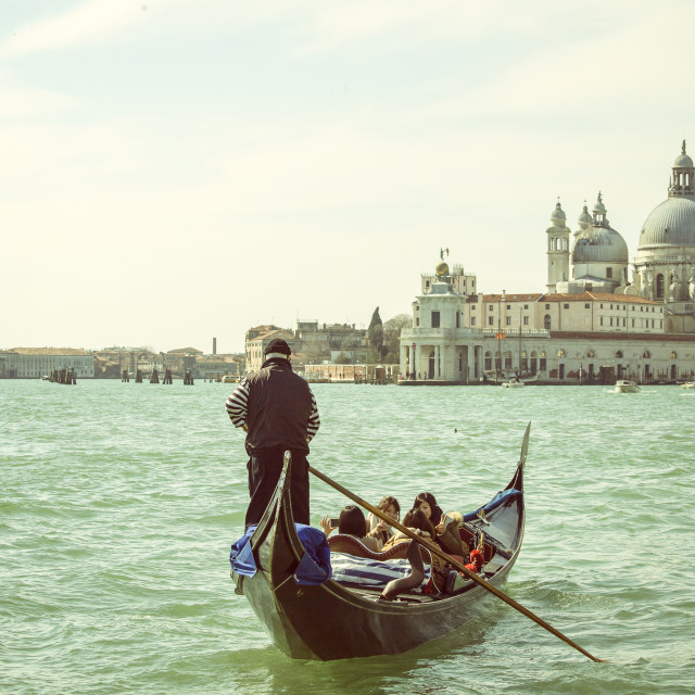 """""""Gondolier with tourists in Venice"""" stock image"""