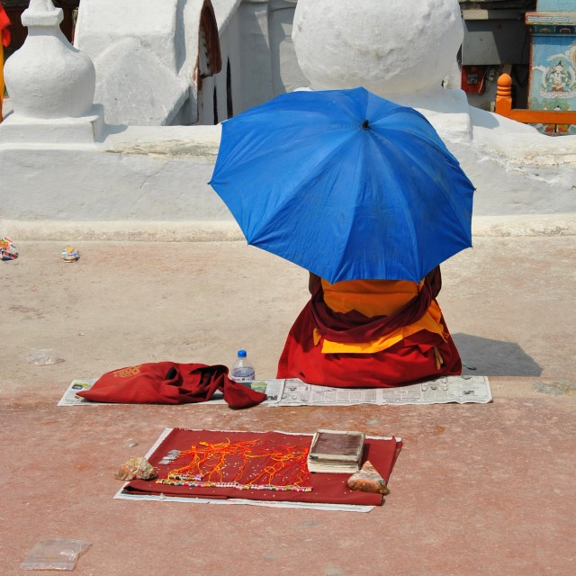 """Buddhist Monk Hides From The Sun"" stock image"