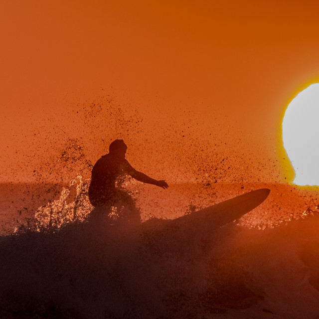 """Surfing The Sunrise"" stock image"