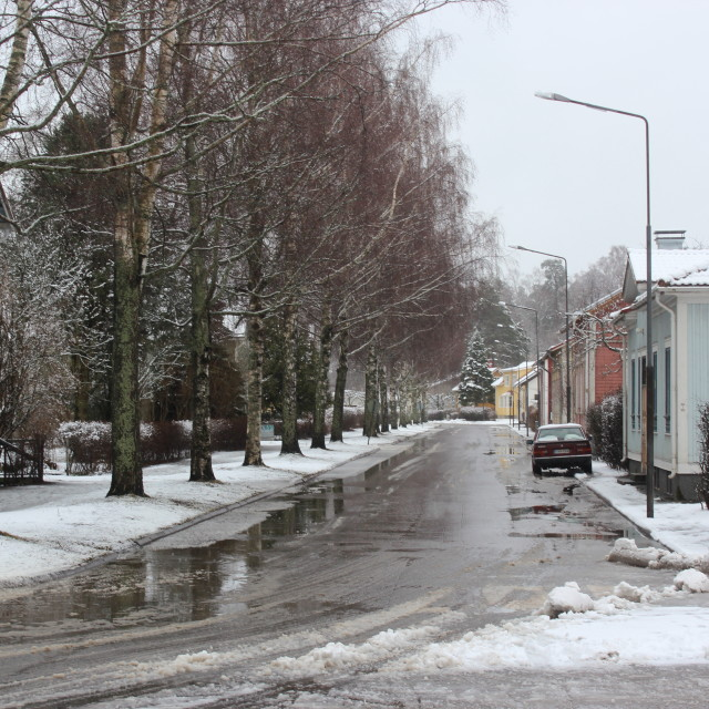 """Snow melting in streets in Ekenas, Finland"" stock image"