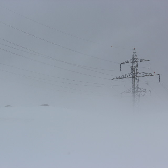 """Snowy power lines on the Bernina Pass"" stock image"