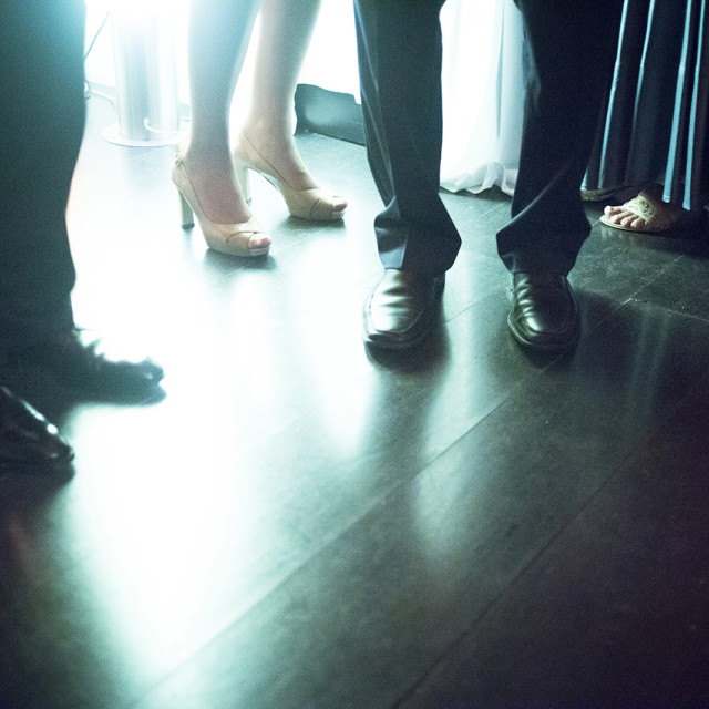 """""""Legs and feet of men and women in wedding marriage reception party"""" stock image"""