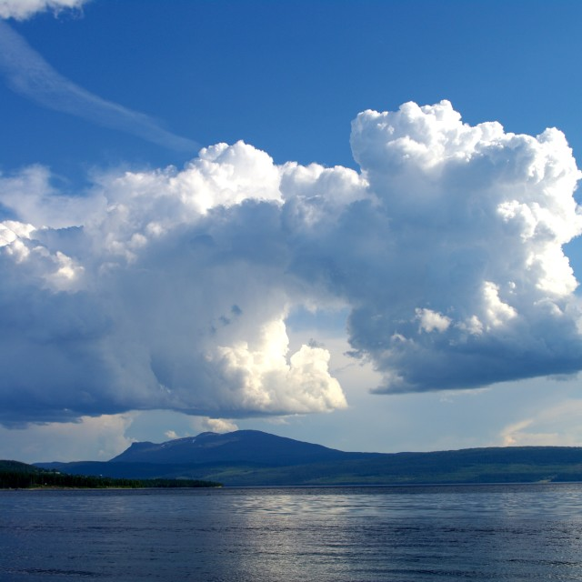 """""""Clouds mounting over mountain and lake"""" stock image"""