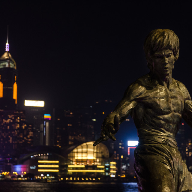 """Bruce Lee in front of Hong Kong"" stock image"