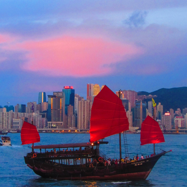 """Junk in Hong Kong Harbour at Sunset"" stock image"