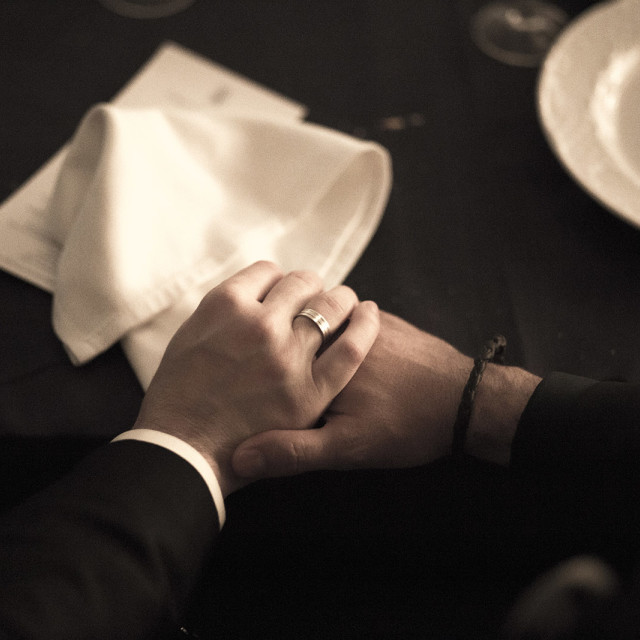 """""""Color Groom and bride in wedding holding hands in marriage dinner"""" stock image"""